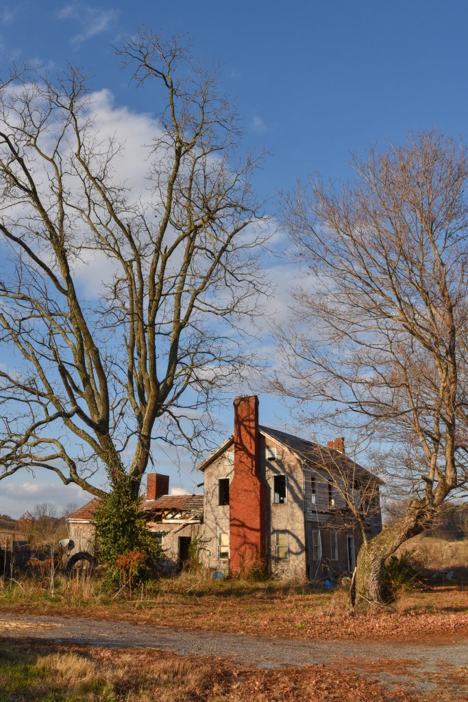 Photograph of an abandoned, burned out farmhouse